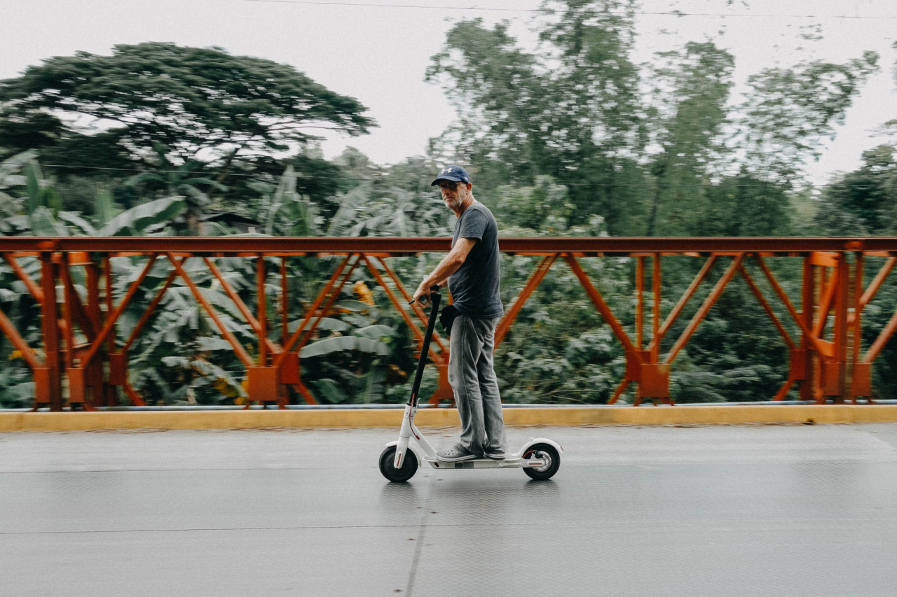man-riding-on-electric-scooter