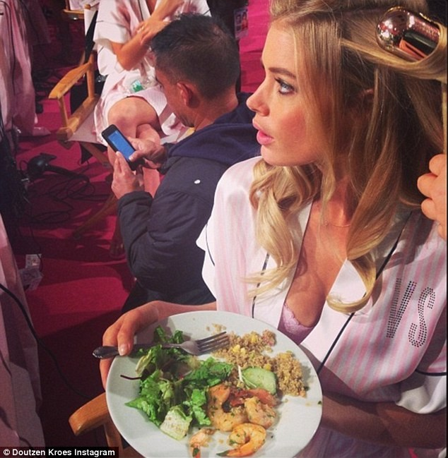 23A8C93B00000578-2856318-The_model_enjoys_a_healthy_lunch_of_prawns_salad_and_quinoa_whil-3_1417525541510